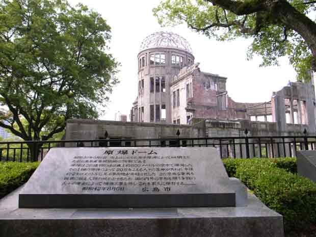 Photographic image of a historical plaque with the Hiroshima Dome in the background